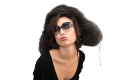 Kiss in ear-flaps fur hat and sunglasses Stock Photo