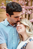 Kiss on the forehead to his girl friend Stock Photography