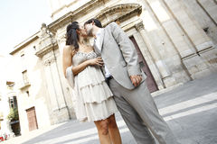 Kiss in front of the church Stock Photos