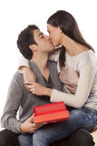 Kiss and gift Royalty Free Stock Photo
