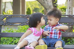 Kiss the girl and the boy in garden Royalty Free Stock Photo
