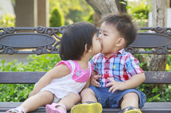 Kiss the girl and the boy in garden Royalty Free Stock Photography