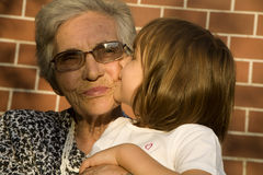 Kiss for grandmother. From granddaughter Stock Images