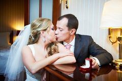 Kiss happy bride and groom Stock Photography