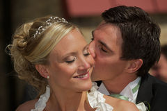 Kiss on her cheek Stock Photo