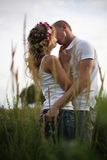 Kiss in a high grass. The young couple kisses in a high grass (Small depth of sharpness stock images