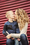 Little boy gives his mom a kiss Royalty Free Stock Images