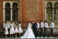 Kiss of the just married with the friends. A Stock Images