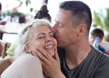 Kiss. Kissing. Delighted and happy woman. Royalty Free Stock Photos