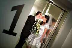 Kiss in the lift Stock Image