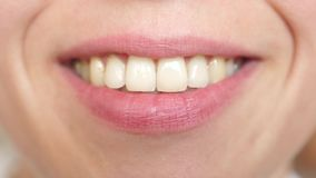 Kiss lips Close-up. beautiful smile of a young woman. girl smiling teeth and lips close-up. stock video footage