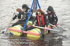 Kiss look-a-likes  in raft race. Stock Photos