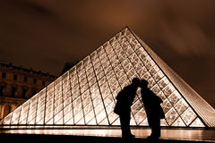 Kiss at the Louvre in Paris France Stock Photo