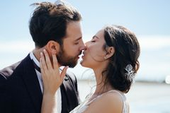 Kiss love bride and groom. stock photos