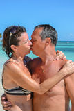 Kiss of love on a white sand beach Royalty Free Stock Image