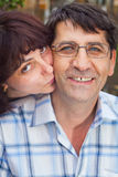 Kiss of love from wife to husband Royalty Free Stock Photo