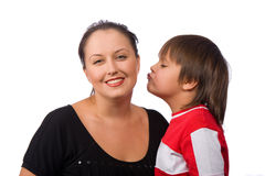 Kiss me. Little boy kissing his mother on the cheek Stock Photo