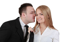 Kiss me. Image of a young couple fun while the women pulls her boyfriend tie for a kiss Stock Photography