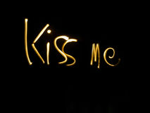 Kiss me. An illustration of the words Kiss Me in artistic golden text on a black background Royalty Free Stock Images