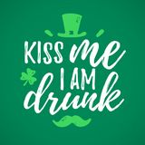 Kiss Me I Am Drunk. Funny handdrawn dry brush style lettering, 17 March St. Patrick`s Day celebration. Suitable for t-shirt, poster, etc Royalty Free Stock Images