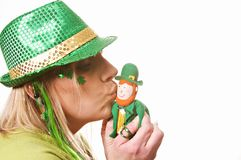 Kiss Me Irish St. Patrick`s Day. A lady kissing on St. Patrick`s Day isolated on white Stock Photo