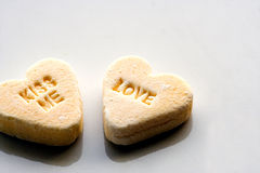 Kiss me love. Candy message stock photography