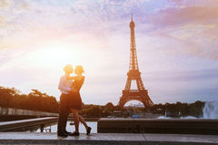 Kiss me in Paris. Silhouettes of loving couple in Paris Stock Photography
