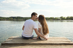 Kiss me sweet!. The kissing couple on the bank of the lake Stock Image
