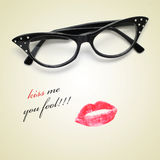 Kiss me you fool. Sentence kiss me you fool and retro-styled eyeglasses and a lipstick mark stock images