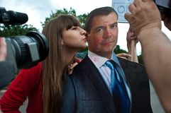 Kiss Medvedev. Action kiss Medvedev in kiss day. Medvedev is president of Russia Royalty Free Stock Photography
