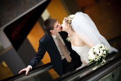 Kiss in metro. Kiss of bride and groom in metro stock images