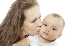 Kiss of mother. Happy mom kisses her little baby Royalty Free Stock Photos