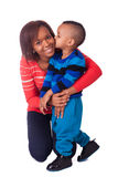 Kiss mother and child. African black women children Royalty Free Stock Photography