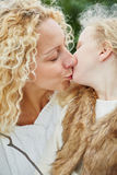 Kiss between mother and daugther. As family love portrait Stock Photo