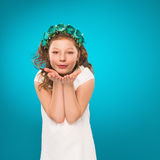 Kiss. Mother's Day. Child. Girl sends an air kiss. Studio photography. Royalty Free Stock Images