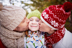 Kiss from parents Royalty Free Stock Photos