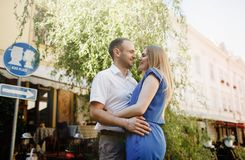 Happy couple in love hugging and kissing on the street old town. royalty free stock photos