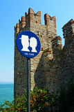 KISS...PLEASE. A fun sign seen by a castle in Italy (Lake Garda in Sirmione), requesting couples to kiss Stock Photography