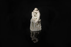 The kiss. Rodin`s kiss on a black background with rteflection Stock Image