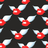 Kiss seamless pattern. Red luscious lips with wings background. Royalty Free Stock Photography