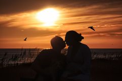 Sunset Kiss. A kiss shared at sunset on a beach Stock Photos