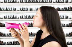 Kiss in the shoe store Stock Image