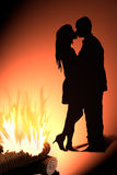 Kiss silhouette in front fire. Illustration of kiss silhouette in front the fire Stock Photography