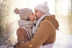 Kiss in snowfall Royalty Free Stock Photos