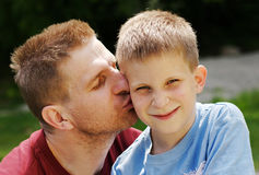 Kiss for son. Father give kiss for his son royalty free stock photo