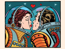 Kiss space man and woman astronauts. Pop art retro style. Valentines day, wedding and love. A girl and a boy. Science and the cosmos Royalty Free Stock Images