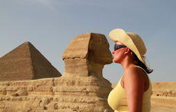 Kiss with the Sphinx. Posing to the kiss with Shpinx in Giza royalty free stock photo