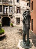 `The kiss` is the statue donated by the Alpini to the city of Bassano and represents the kiss between an alpine and his beloved. Royalty Free Stock Photography