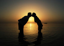 Kiss at  sunrise in Egypt. Loving couple at sunrise in Red Sea Royalty Free Stock Photo