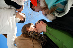 Kiss of three adult couples Royalty Free Stock Images